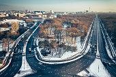 wide Berlin skyline over Tiergarten with tv-tower an main traffic lines in winter sun