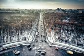 wide Berlin skyline over Tiergarten with main traffic lines in winter sun