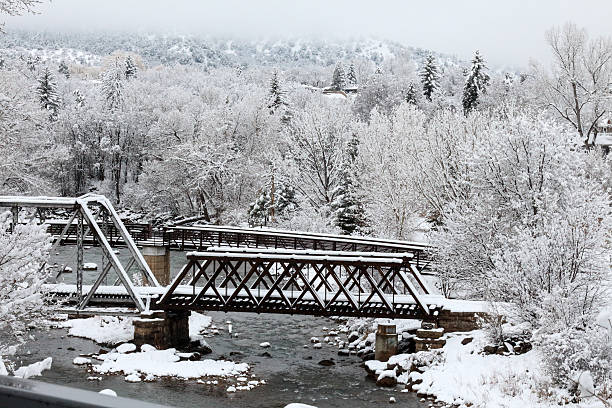 Wintertime Animas River Bridges Frozen landscape in Durango, Colorado animas river stock pictures, royalty-free photos & images