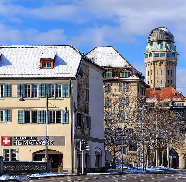 wintertime view in zurich, switzerland - weltzeituhr stock-fotos und bilder