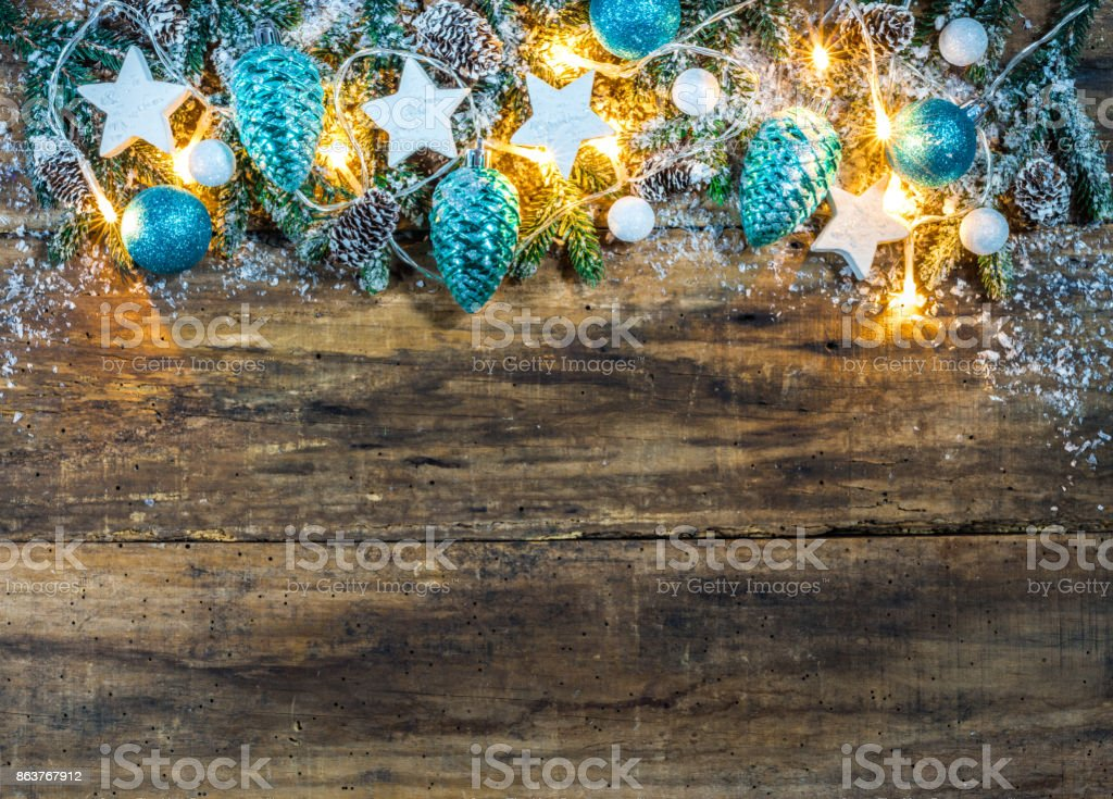 wintry christmas background with blue and white ornaments and festive light royalty free stock photo