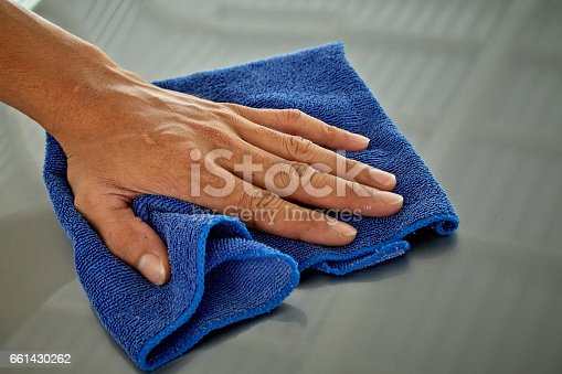 istock Wipe with a cloth blue 661430262