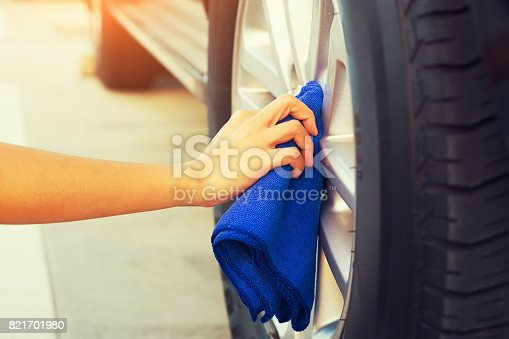 istock wiping alloy wheels 821701980