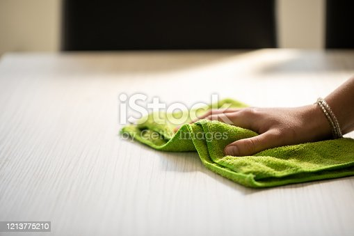 wiping dust with a cloth, dusting