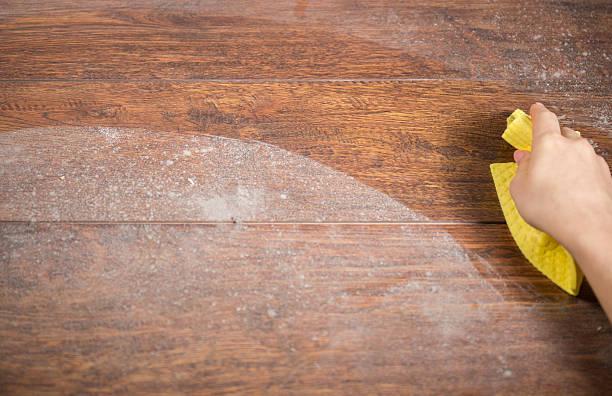 Wiping dusty wood using rag stock photo
