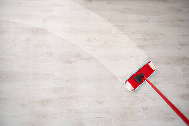 Wiping floor and cleaning Wiping floor during spring cleaning mop stock pictures, royalty-free photos & images