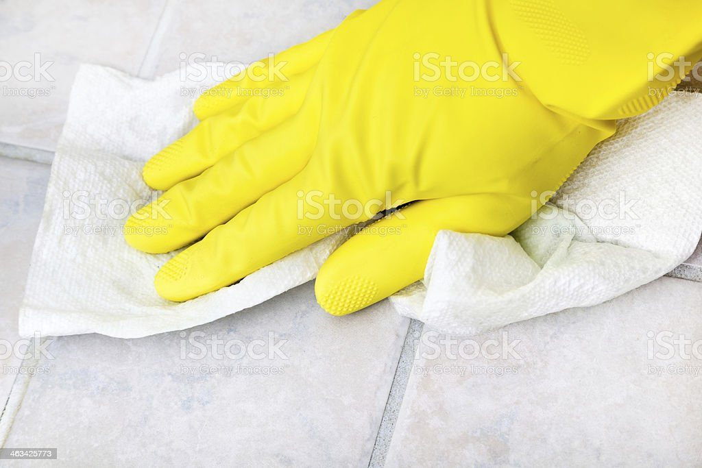 Wiping off Ceramic Tiles stock photo