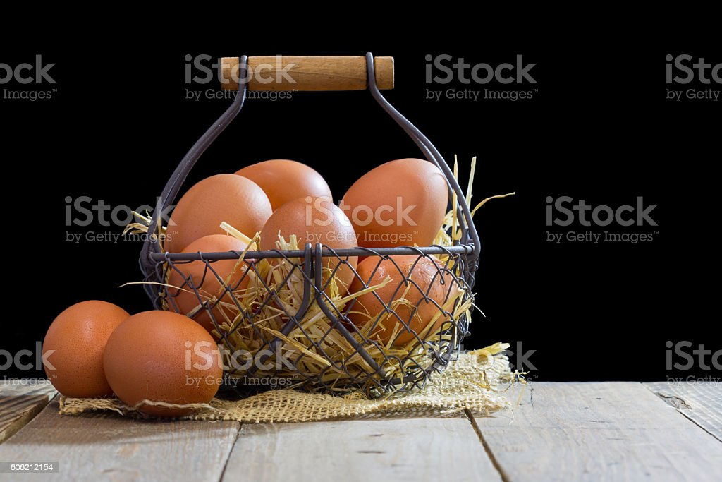 Wire basket with eggs stock photo