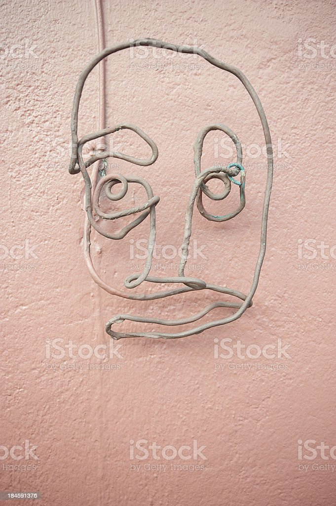 Wire Face on Pink Wall stock photo