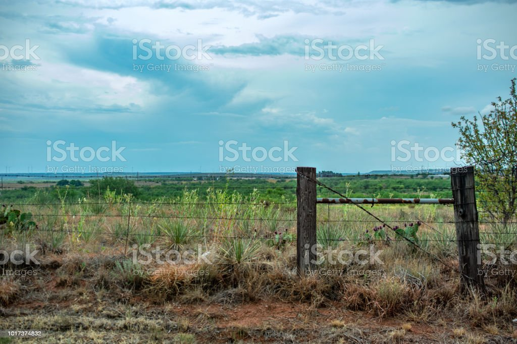 wire fence and post with sky Texas stock photo