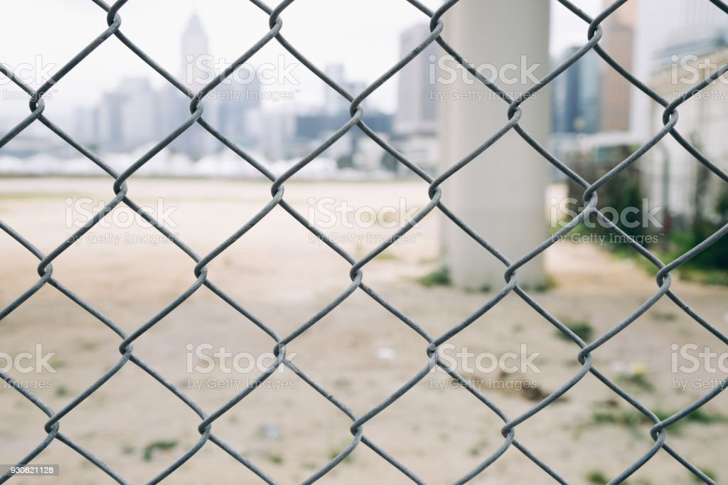 Wire fence with Hong kong cityspace stock photo