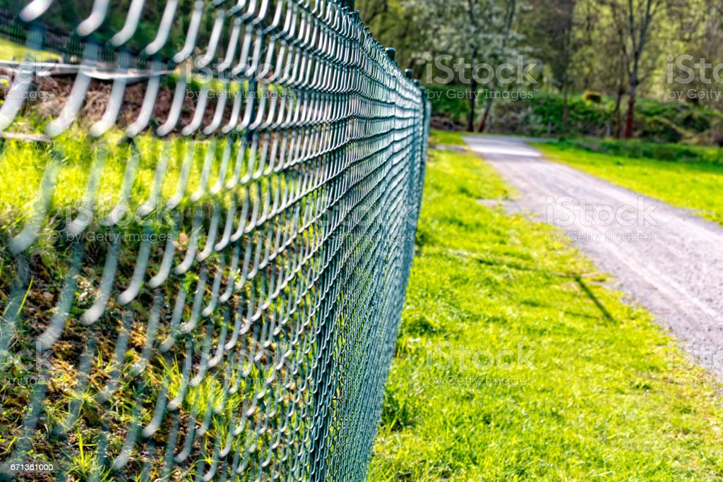 Wire mesh fence fenced plot stock photo