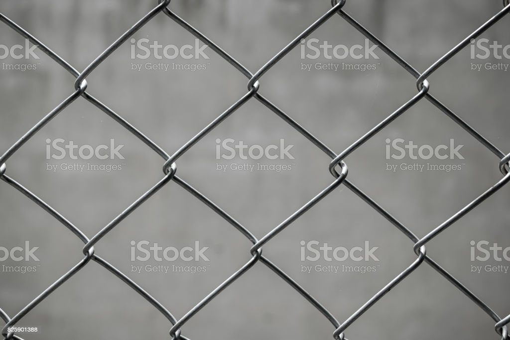 Wire Mesh Of Fence At Home With Concrete Wall In The Background For ...