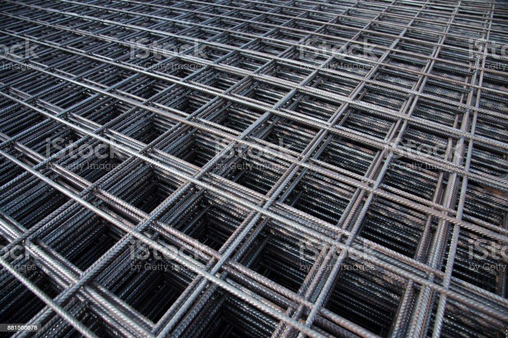 Treillis métallique en acier ronds à béton renforcé concrete.steel texture de barre renfort en chantier. - Photo