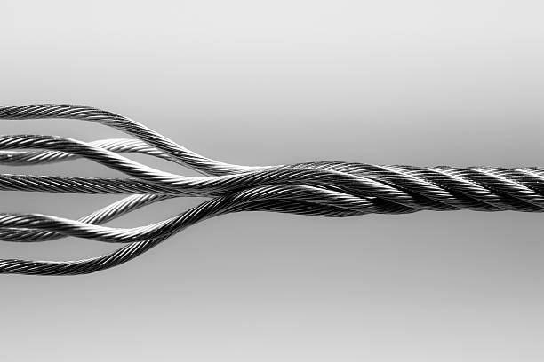 wire rope. steeltwisted connection cable abstract strength concept - twisted stock pictures, royalty-free photos & images