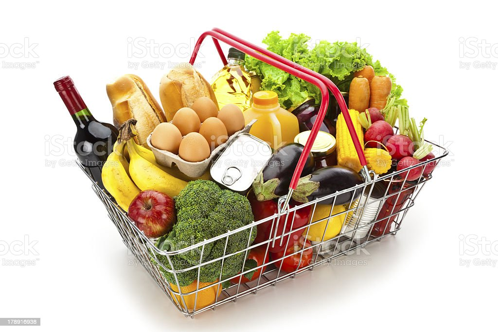 Wire shopping basket filled with colorful food isolated on white stock photo