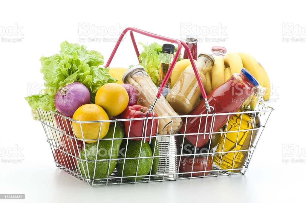 Wire shopping basket filled with groceries and vegetables stock photo