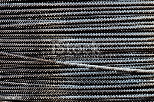 Close-up stacked wire steel rebar material, rebar for industrial and construction work, texture and background