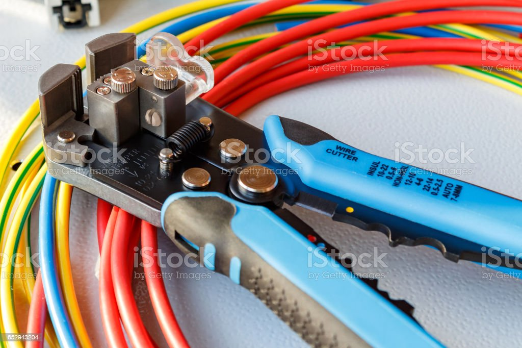 Wire stripper and cutter with colored wires stock photo