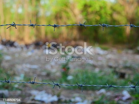 91708255 istock photo wire stuck to fencing 1146509704