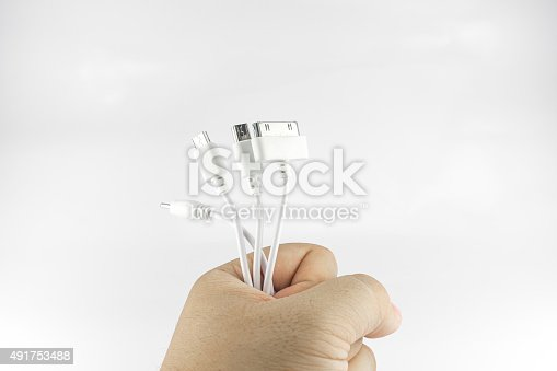 White wire usb mobile charging cable in hand on white background.