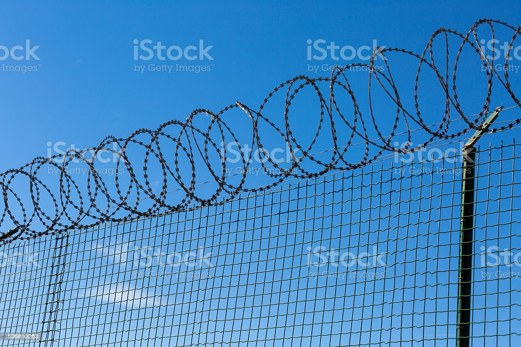Wired Fence with Spiral Barbwire stock photo