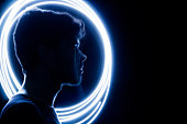 Wireframe human profile face portrait on blue, technological background. Circle light painting, Man silhouette