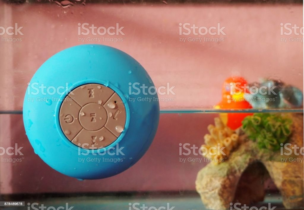 Wireless accessory device for smartphone and pc with speaker and  mic for wet ambients stock photo