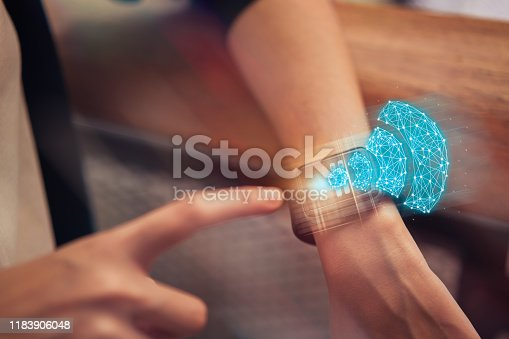 Wireless and connection network technology concept, woman touching on smart watch with show wifi icon at the mall.