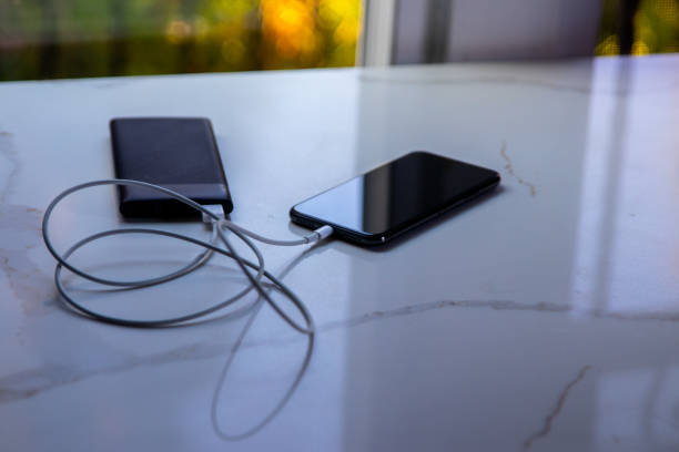 Wireless charging an iPhone smartphone stock photo