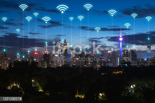861165648 istock photo Wireless communication network in Big city in Asia concept. Abstract wifi icons on Kuala lumpur city landmark background 1221232219
