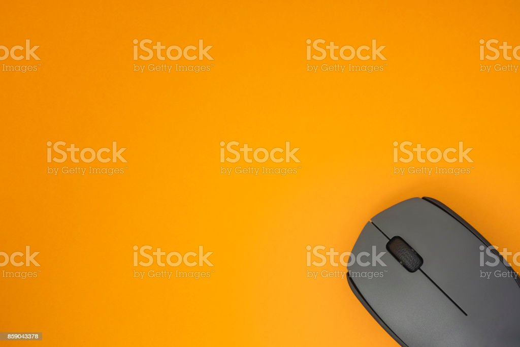 Wireless Computer Mouse On Yellow Background. stock photo