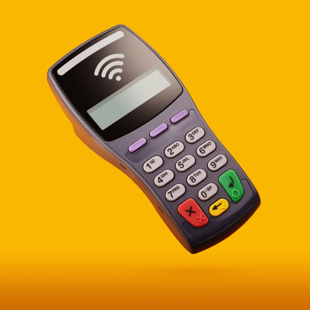 Wireless, contactless credit card reader. Electronic banking terminal over yellow / orange background stock photo