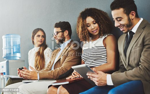 858111468 istock photo Wireless distractions while they wait 858111438
