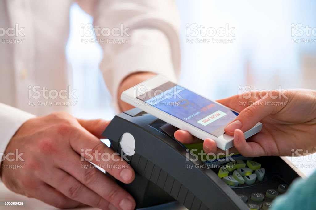 Wireless payment using smartphone and NFC technology. royalty-free stock photo