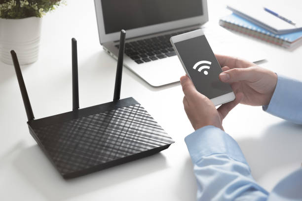 Wireless router concept. Man using smartphone – zdjęcie