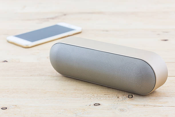 Wireless speaker for mobile phone, Speaker for smartphone. Wireless speaker for mobile phone, Speaker for smartphone on wood desk Background. bluetooth stock pictures, royalty-free photos & images