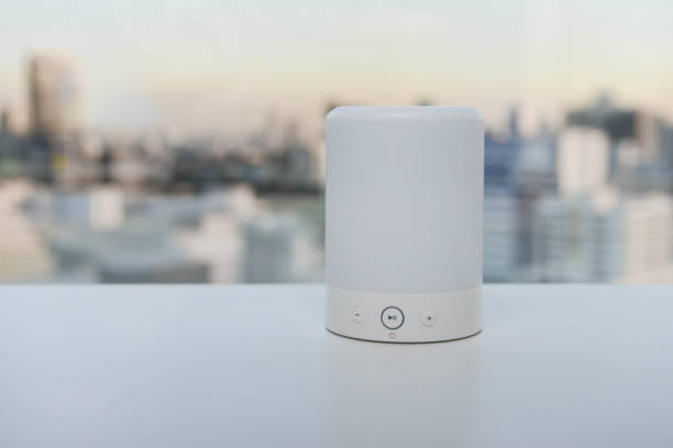 Wireless speaker on the white table stock photo