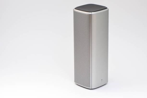 Wireless speaker - wireless mobile technology - On white background stock photo