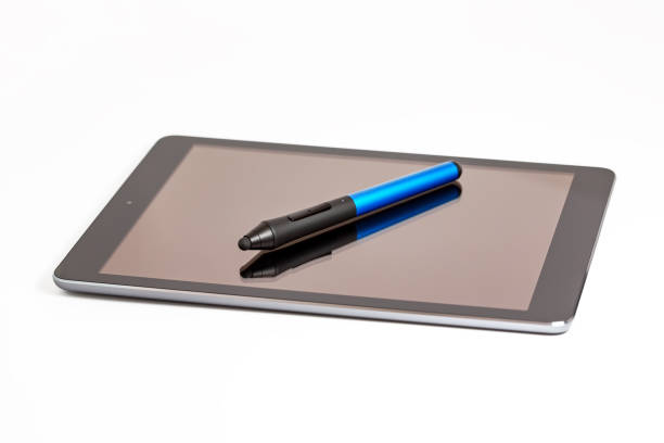 Wireless stylus lies on the screen of a modern digital tablet on a white background stock photo