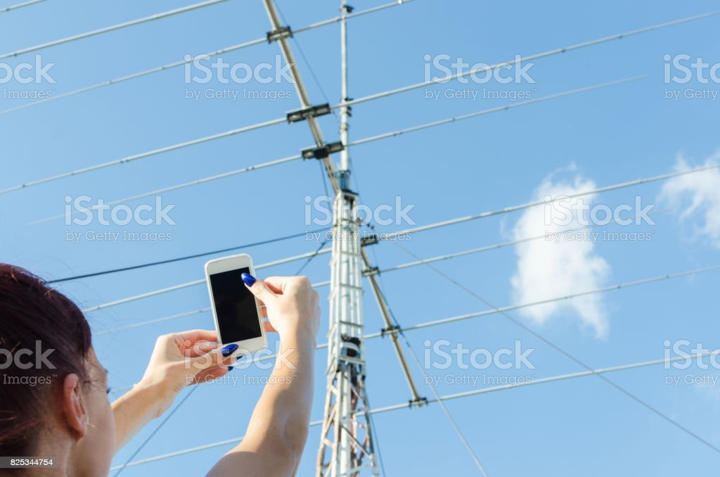 wireless system technology and female hands holding phone stock photo
