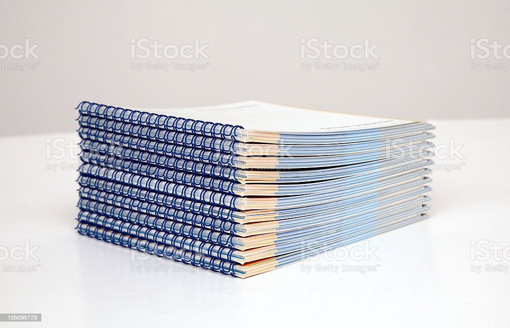 wire-o binding - stack of booklets stock photo