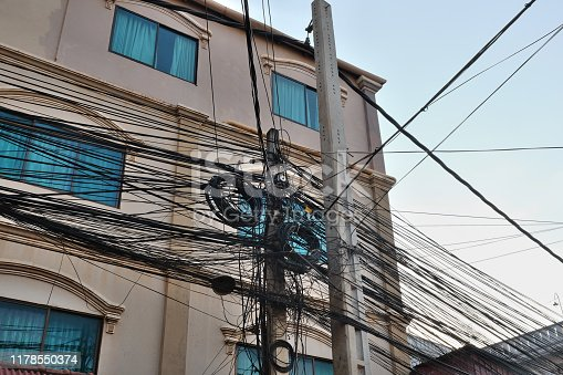 Wires of power lines. Skeins of wires. Tangled electrical wires.