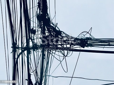 Chaos of Wires and Telephone Line on The Pole at Bangkok, Thailand.