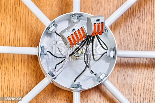 istock Wiring of a modern ceiling chandelier for LED light bulbs. 1185284008