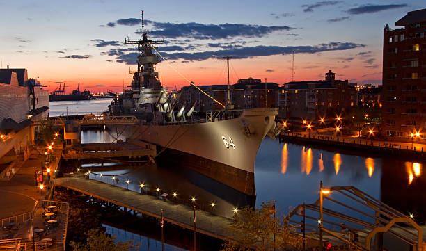 USS Wisconsin Battleship (BB-64) in Norfolk, Virginia, at sunset stock photo