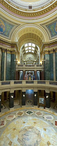 Wisconsin Capitol Rotunda A panoramic view of the West Gallery and rotunda of the Wisconsin state capitol wisconsin state capitol stock pictures, royalty-free photos & images