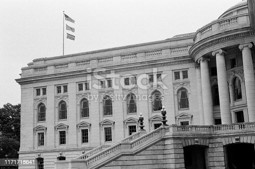 Wisconsin state Capitol building with LGBT flag flying for first time in June 2019 shot in black and white film for vintage look