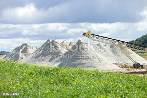 Piles of frac sand at the end of a conveyor at a new Wisconsin mine.