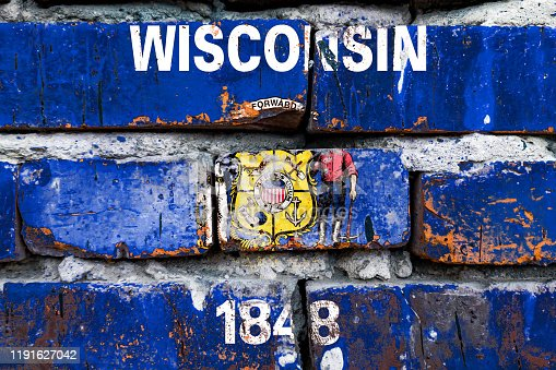 Wisconsin grunge, damaged, scratch, old style united states flag on brick wall.